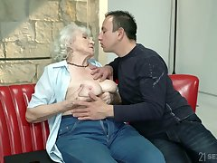 Whorish granny Norma gets intimate with one hot blooded young lady's man