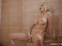 Blonde Amber Jayne takes a shower before a fianc� about fishnet stockings