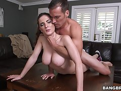 Busty natural slut shoves big inches in her tight cunt